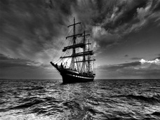A Three-Masted Ship on the Ocean: Black and White Photograph